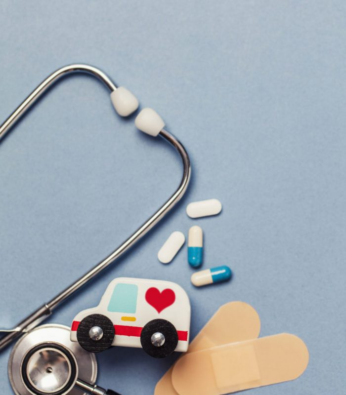 Healthcare background with stethoscope and ambulance